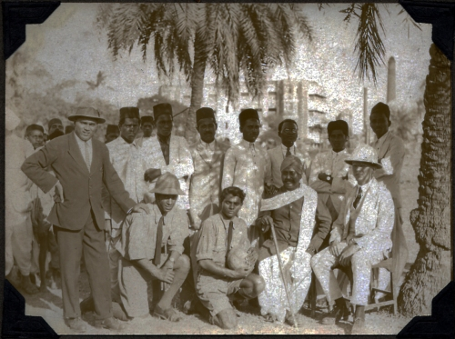 William Earl Dodge Ward (seated at right), son and grandson of missionaries, and married to Dora Judd Mattoon Ward, herself a missionary.  With his staff in Bombay, c. 1930.