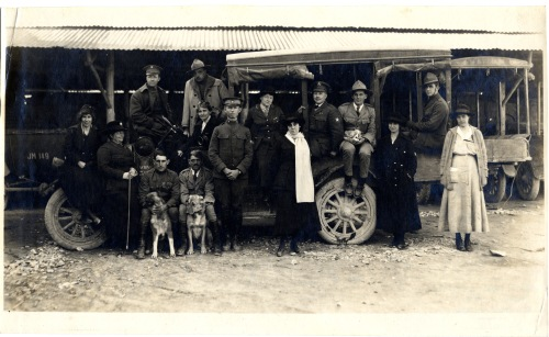 Charles Weeden is seated to right of center, with puppy.  George R. Swain, photographer.
