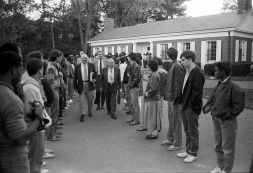 Protesters line the path of the Trustees leaving the October 1985 Trustee meeting