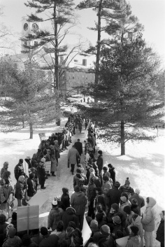 Protesters line the path after a Trustee Investment Committee meeting with faculty and students pushing for divestment, December 1977