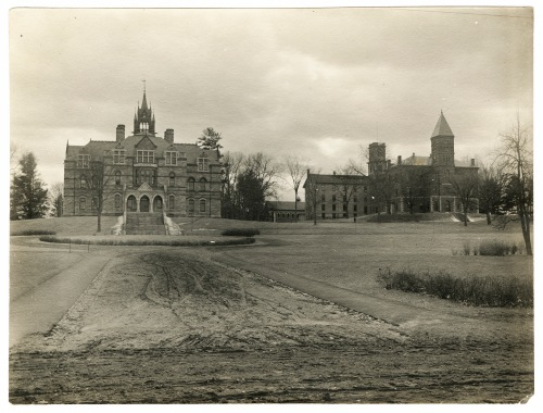 This picture was take looking south at Walker Hall (left) and Williston Hall and college row (right). Forbes was standing on what would now be the street in front of the Armes Music Center.