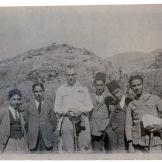 "On verso, Laurens wrote: ""Our Fifth Form picnic. Left to right, Garbis [Nevulafian] (Armenian), Mahmoud Khalid (Moslem), Hussein Sijan (Moslem), Omar Fayid (Moslem), Hovhannes Tabourian (Armenian)"""