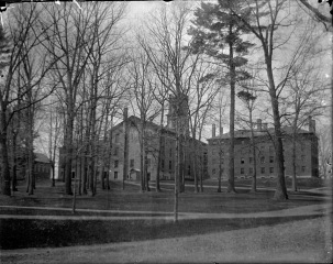 Known at the time as College Grove, now known as the Freshman Quad, this image also shows the college well directly behind Johnson Chapel, 1896