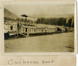 """Our house boat"" (page 3, photograph 1)."