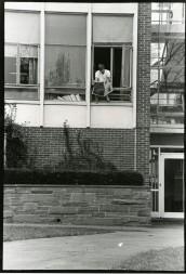 Social dorms- student in Pond window B&G b19 f23