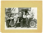 """Theatre Lobby cast of """"Love Rides the Rails"""" posed in front of a Stanley Steamer that was being restored in a shop across the alley from the Theatre Lobby building.  Muriel Seelye Heineman, Mary-Averett's younger sister, also performed with Theatre Lobby and had a career in teaching drama.  She is shown standing at right."""