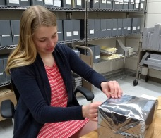 Olivia Gieger '21 packaging films for cold storage.