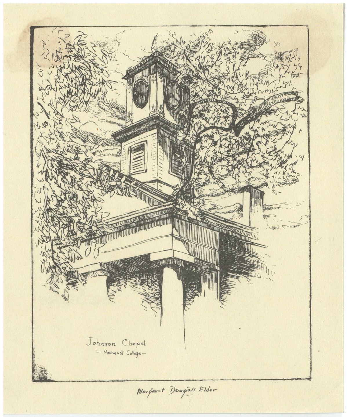 A square clock tower stands above an upper corner column. Tree branches in full leaf frame the tower.